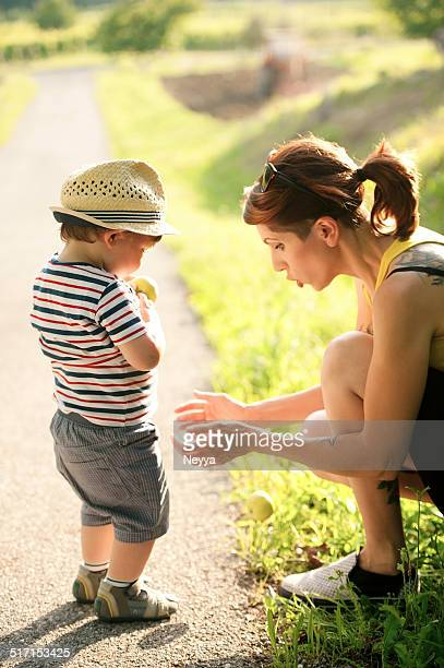 Young Mother and her Son Enjoying Summer
