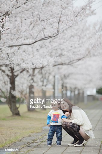 young mother and her son looking up : Stock Photo