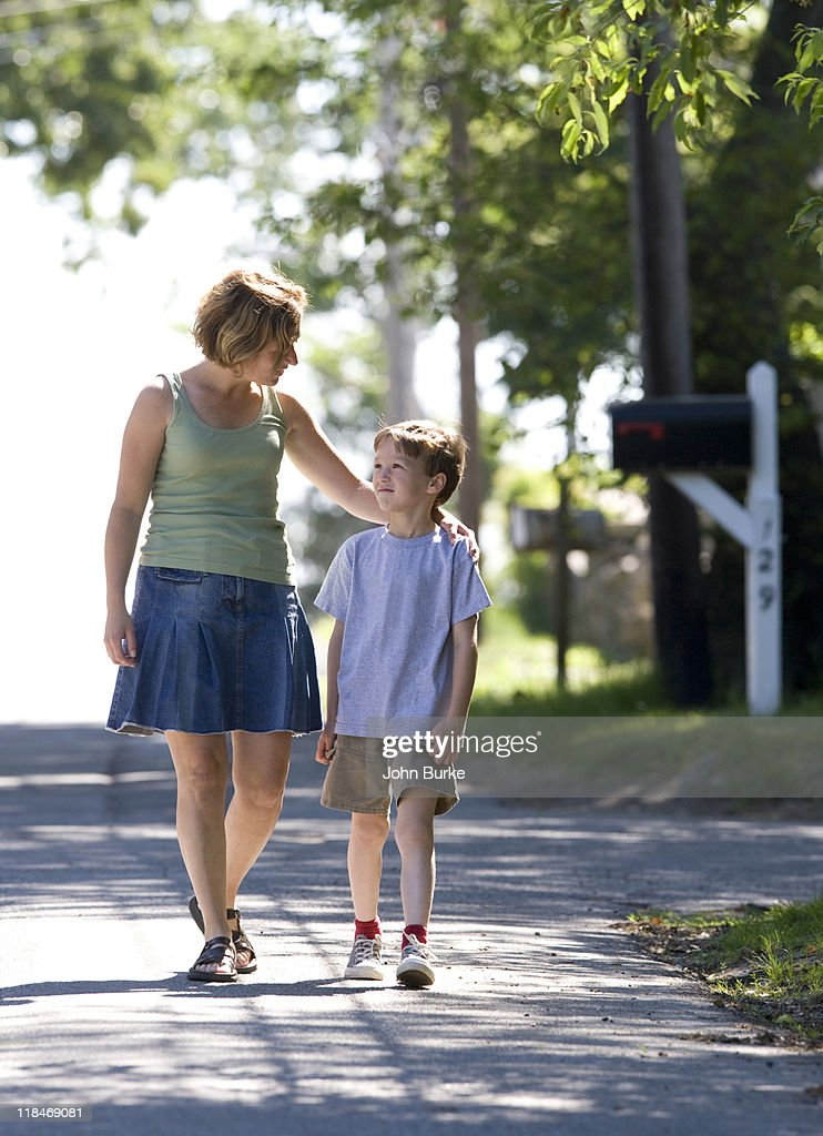 young mother and son walking : Stock Photo