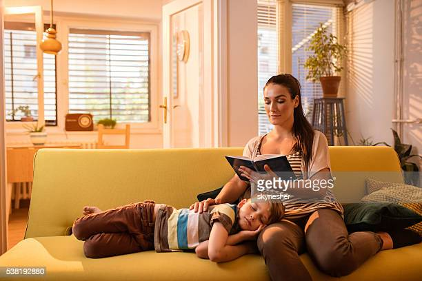 Young mother and tired little boy relaxing at home.