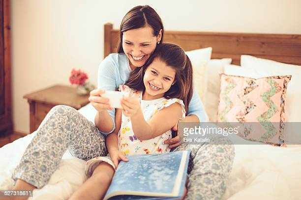 Young mother being together with her playful daughter