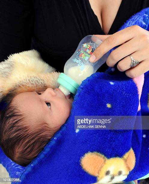 A young mother bottle feeds her baby in the 'Basma' protection unit in Casablanca on May 25 2010 The 'Basma' protection unit provides protection to...
