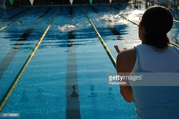 Young Mother Cheering Her Daughter at a Swim Meet