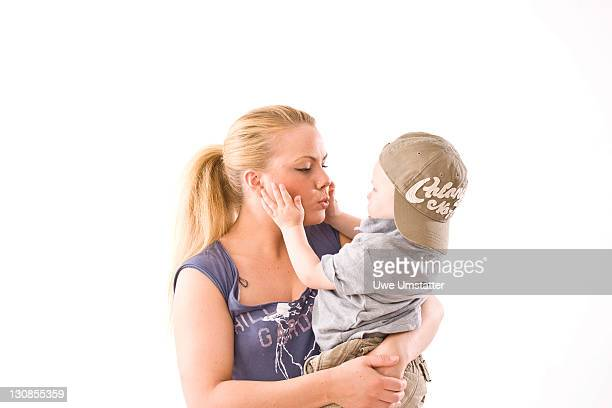 Young mother embracing her two-year-old son
