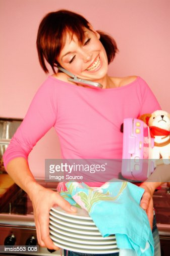 Young mother multi-tasking : Stock Photo
