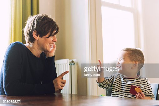 Young mother playing with her mixed race son