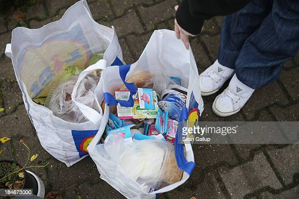 A young mother prepares to depart after buying groceries at the Falkenseer Tafel food bank on October 15 2013 in Falkensee Germany The International...