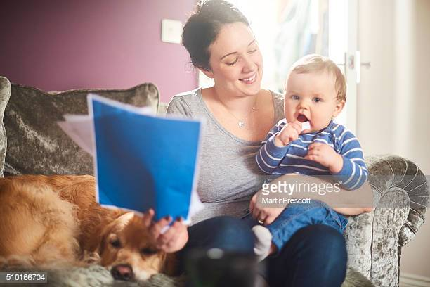 young mother reads through household insurance policy