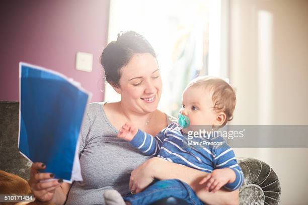 young mother reads through mortgage agreement