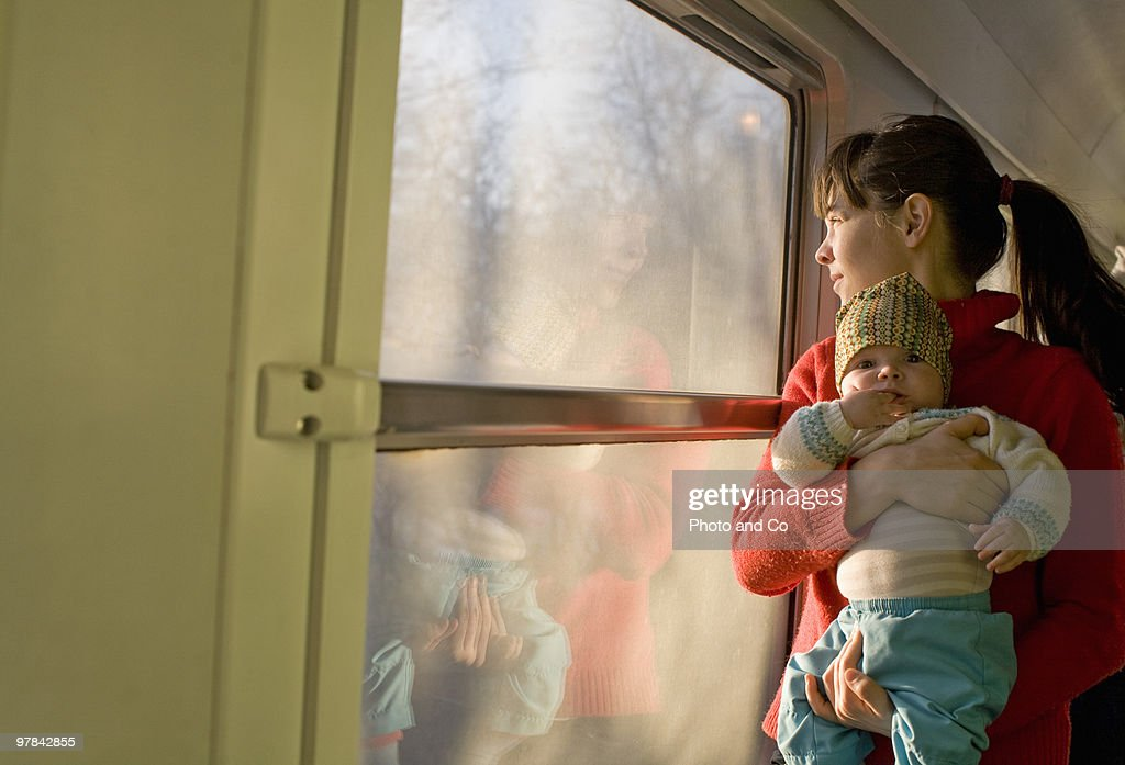 Young mother with her baby in the train : Stock Photo