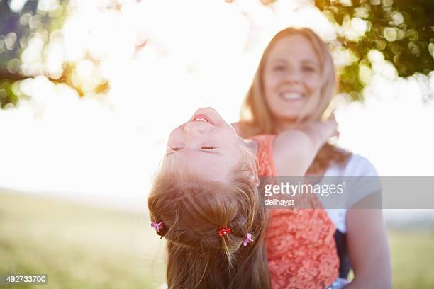 Young mother with little girl having fun