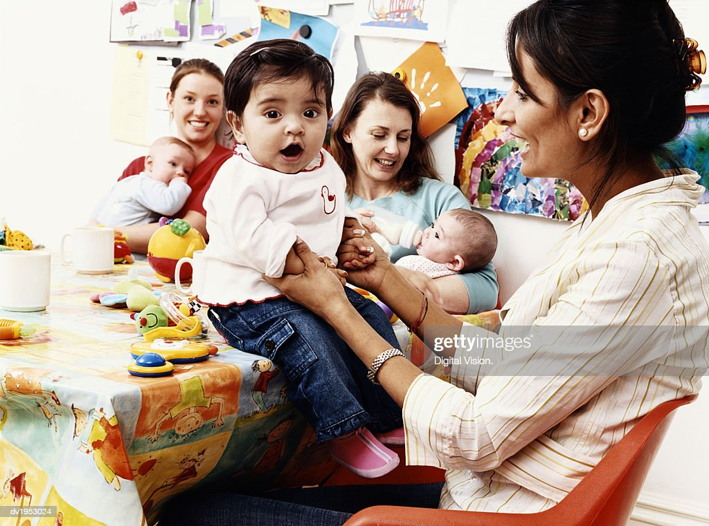 Young Mothers and Babies in a Kitchen