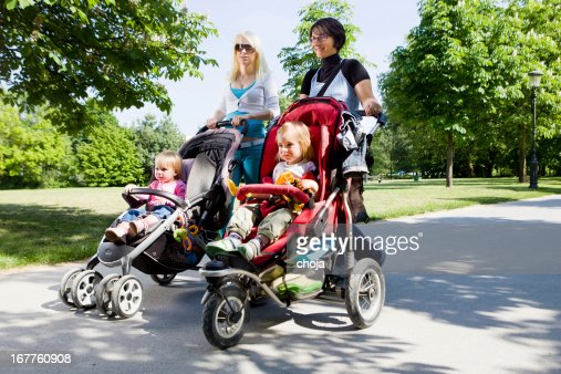 Young mothers in a park walking their babies