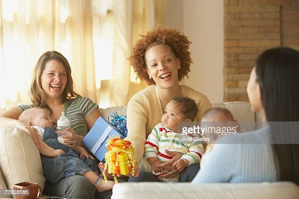 Young mothers with babies and gifts