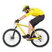 young man with beard riding yellow mountain bike