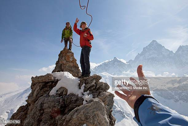 Young mountaineer tosses rope for teammate