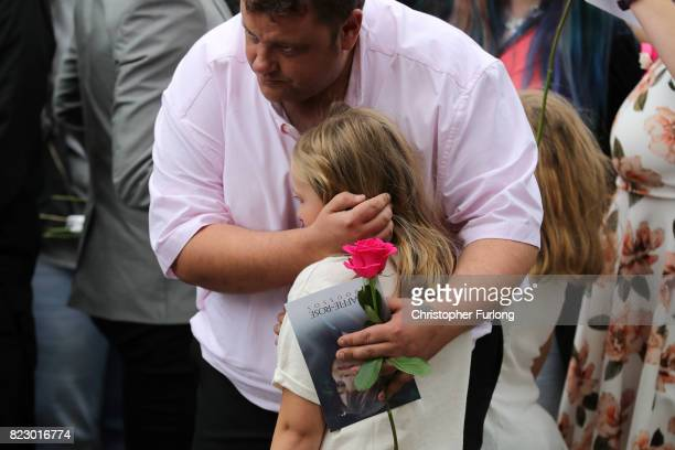 A young mourner is comforted after the funeral of Manchester Attack victim Saffie Roussos arrives at Manchester Cathedral on July 26 2017 in...