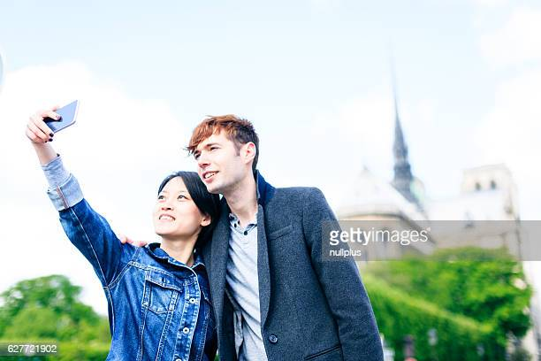 Young multi-ethnic couple enjoying their trip to Paris, France
