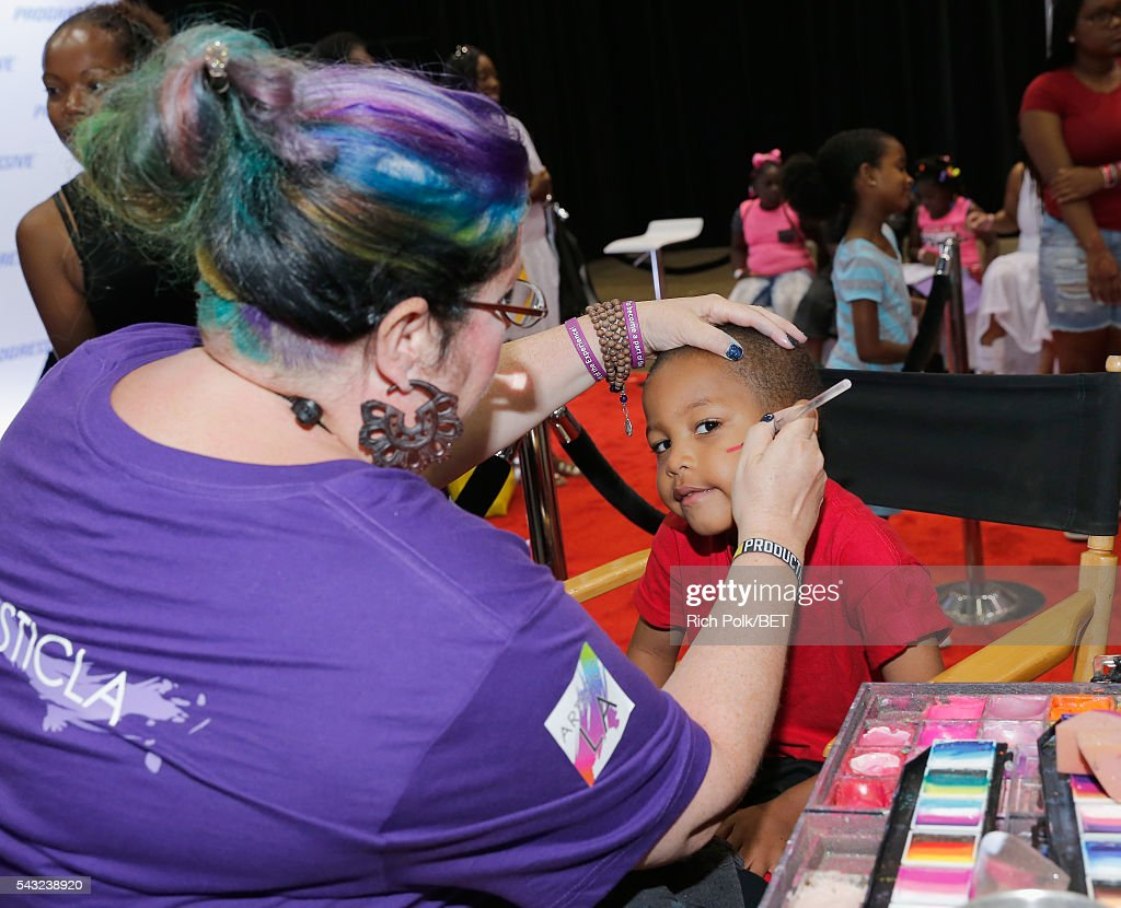 Young music fan attends the Fan Fest during the 2016 BET Experience on June 26, 2016 in Los Angeles, California.