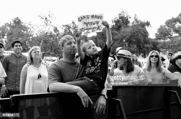 A young music fan holds up a sign that reads 'Can I Have Your Pick' during Arroyo Seco Weekend at the Brookside Golf Course at on June 24 2017 in...