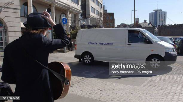 A young musician watches as the body of Gene Pitney is taken from the Hilton Hotel in Cardiff in a private ambulance passing the battlement wall of...