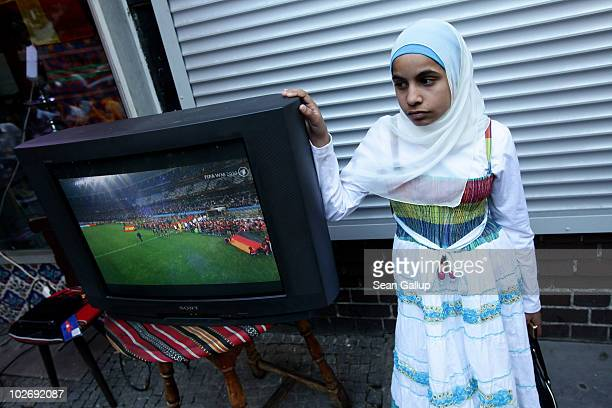 A young Muslim girl joins local residents in the Arab and Turkishheavy neighborhood of Neukoelln watching the FIFA 2010 World Cup match between...