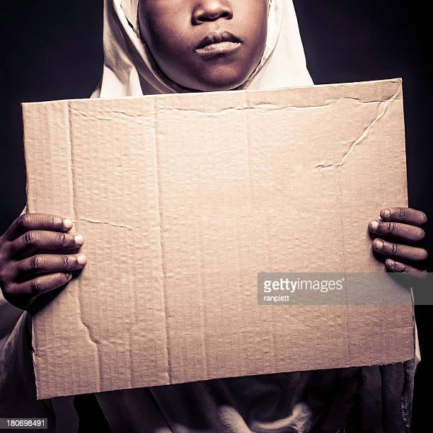 Young Muslim Girl with a Sign (Isolated on Black)
