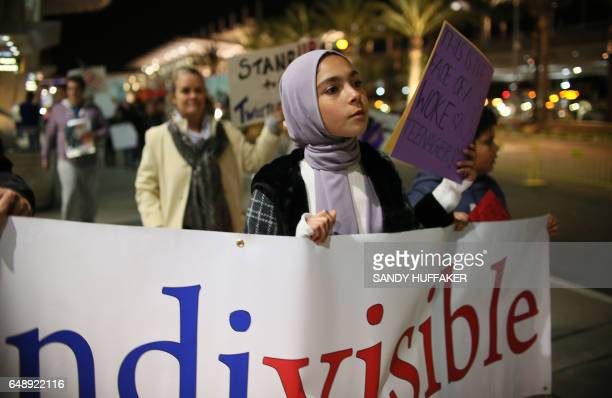 A young muslim Protester who did not want to be named marches during a rally against the travel ban at San Diego International Airport on March 6...