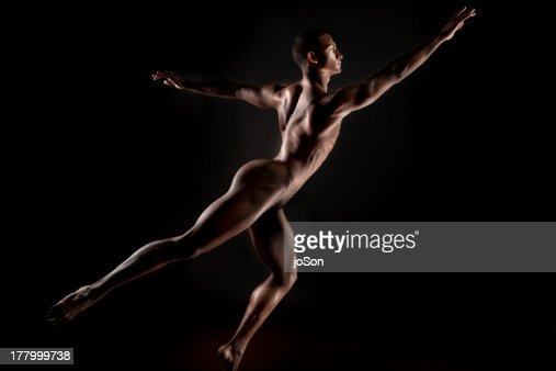 Young naked make in dander pose. : Stock Photo