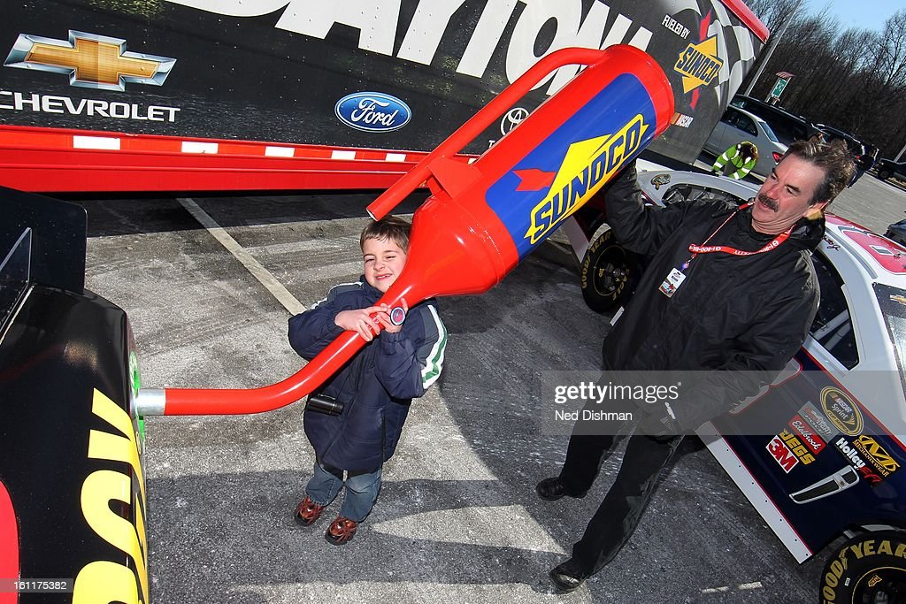 A young NASCAR fan pretends to put fuel in the next generation racecar during a Road to Daytona Fueled By Sunoco Tour stop at the Sunoco Station on February 9, 2013 in Newark, Delaware.