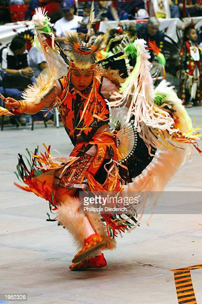 A young Native American participates in an intertribal dance at the 20th annual Gathering Of Nations PowWow April 25 2003 in Albuquerque New Mexico...