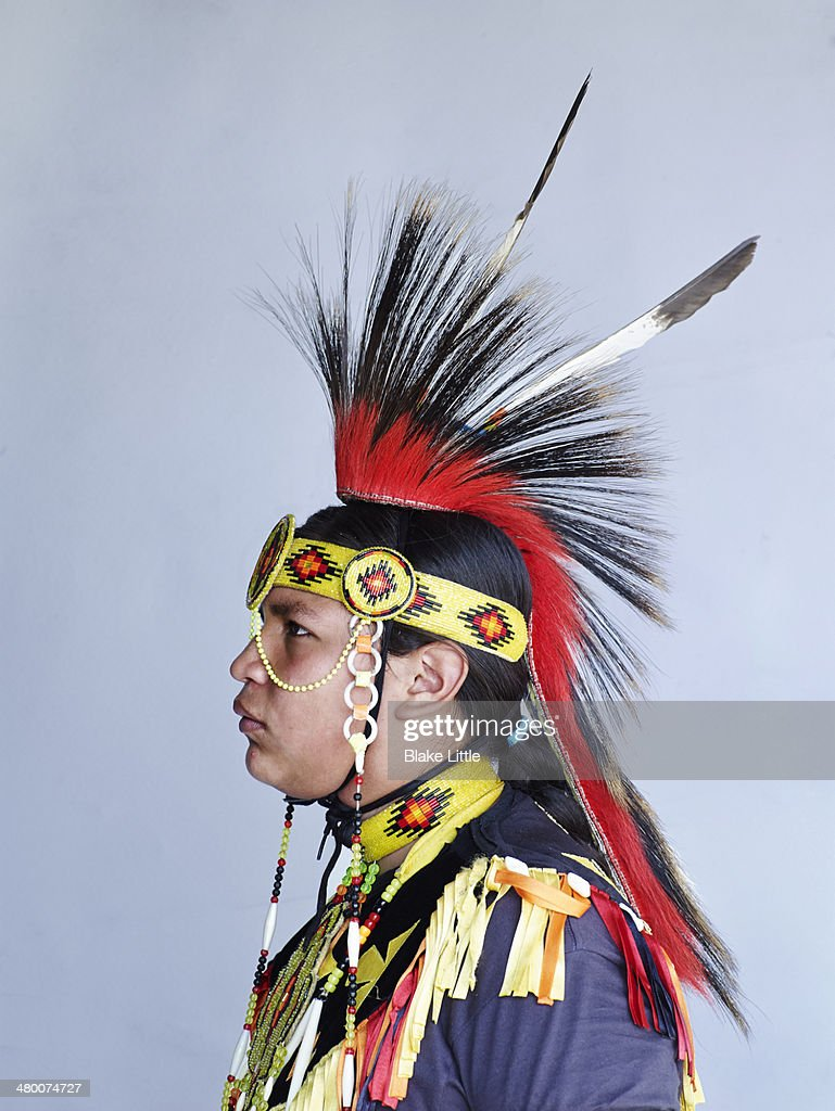 Young native man with head dress : Stock Photo