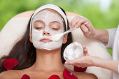 Young Natural Relaxing Beauty Having Moistening Mask Applied.