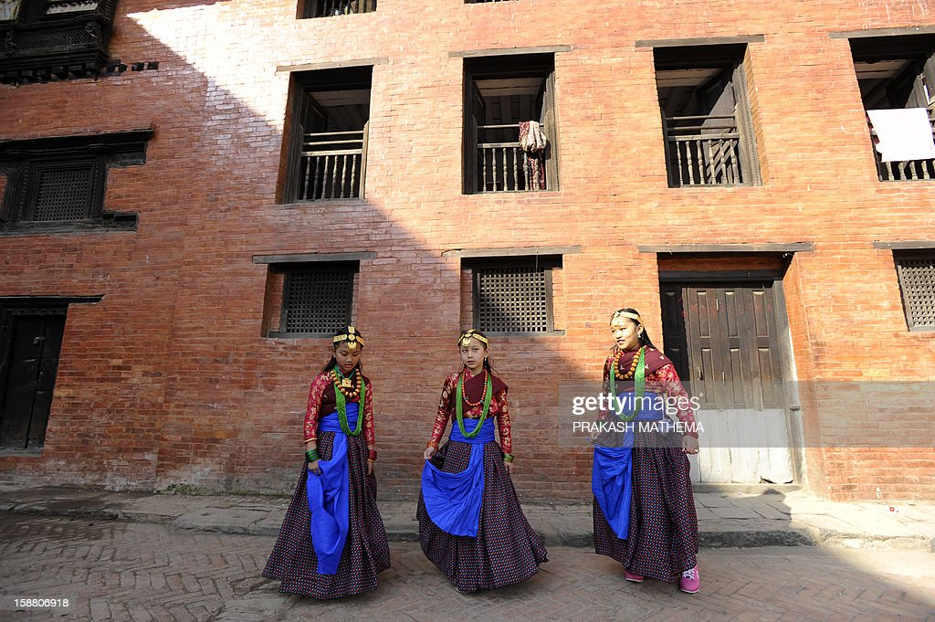 Young Nepalese indigenous Gurung children in traditional attire prepare to take part in a New Years celebration ceremony known as 'Tamu Lhosar ' in Kathmandu on December 30, 2012, held to celebrate their New Year or Lhosar. Gurungs number some 700,000 people about three percent of the Himalayan nation's population and are mainly concentrated in the country's central region. AFP PHOTO/Prakash MATHEMA