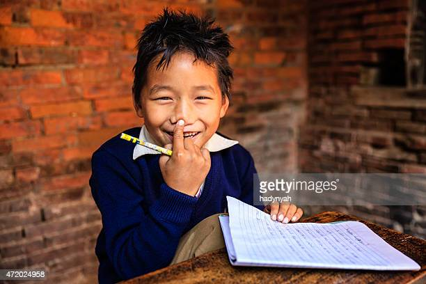 Young Nepali boy in classroom