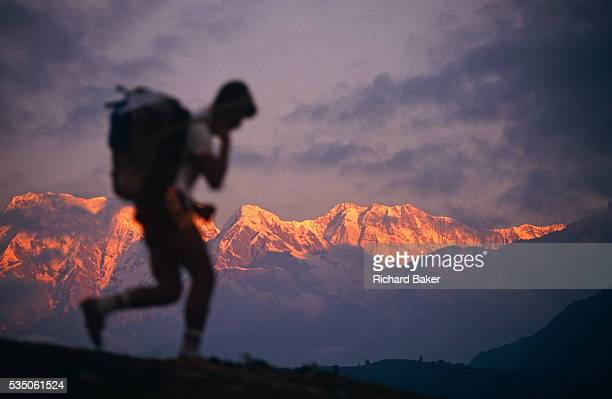 A young Nepali boy is undergoing a recruitment test for the Gurkha Regiment called the Doko race part of a tough endurance series to find physically...