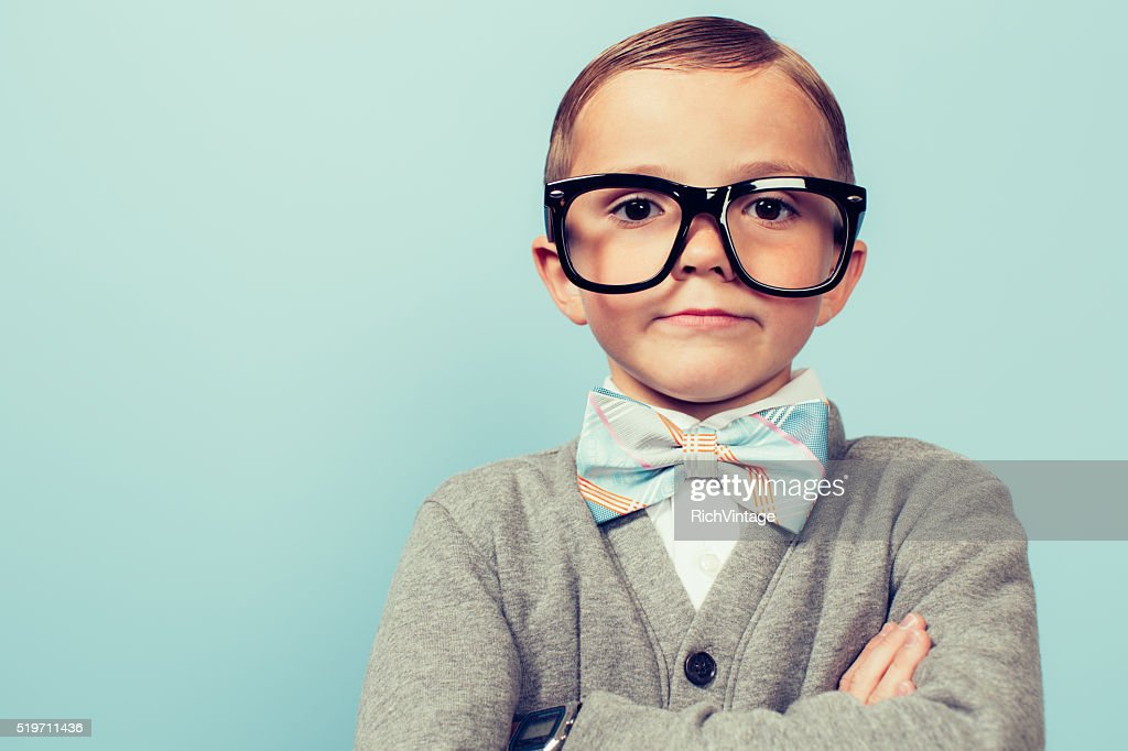 Young Nerd Boy Folding Arms and Blank Expression : Stock Photo