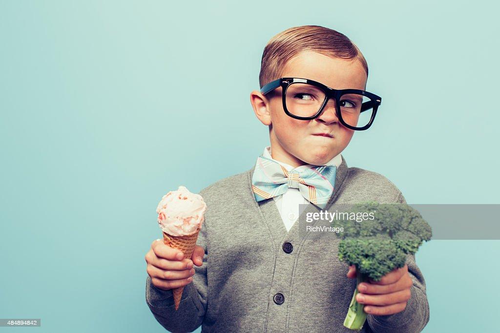 Young Nerd Boy Hates Eating Broccoli : Stock Photo