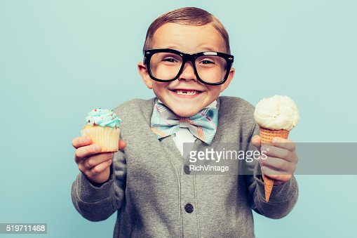 Young Nerd Boy Holds Ice Cream and Cupcakes