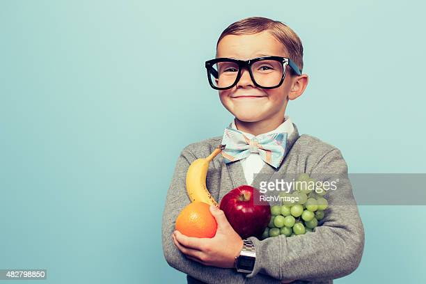 Young Nerd Boy Loves Eating Fruit