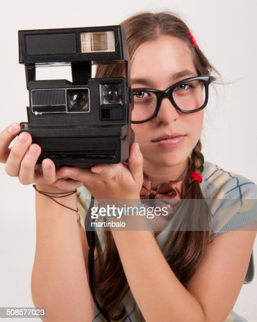 young nerdy photographer holding an instant camera. : Stock Photo