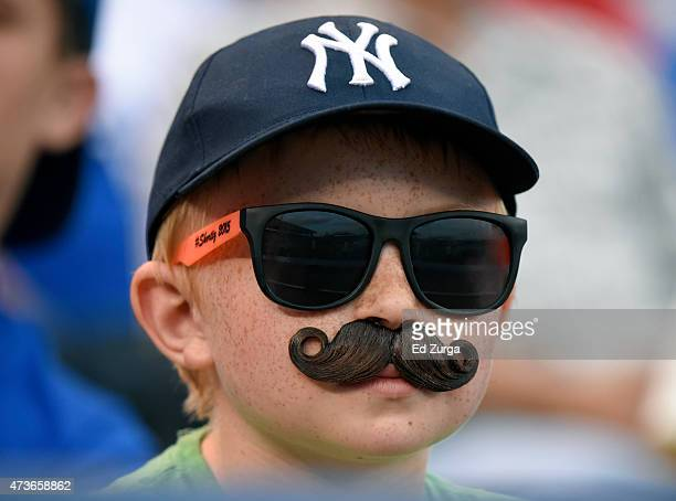 A young New York Yankees fan watches the Yankees play against the Kansas City Royals in the third inning at Kauffman Stadium on May 16 2014 in Kansas...