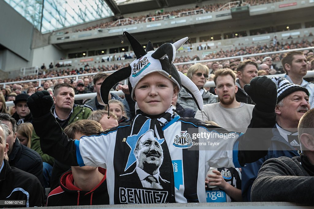 A young Newcastle Fan celebrates whilst wearing club merchandise during the Barclays Premier League match between Newcastle United and Crystal Palace at St.James' Park on April 30, 2016, in Newcastle upon Tyne, England.