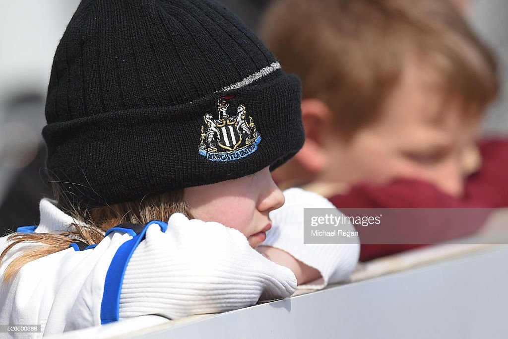 A young Newcsstle United fans looks on prior to the Barclays Premier League match between Newcastle United and Crystal Palace at St James' Park on April 30, 2016 in Newcastle upon Tyne, England.