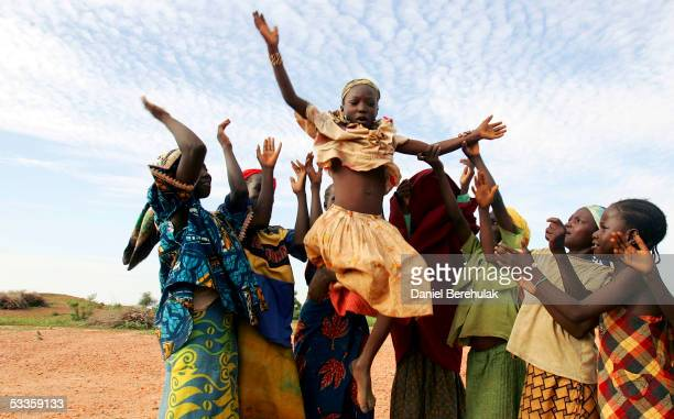 Young Nigerois women perform a traditional Huru Ruki dance for good luck and prosperity in the village of Sadongori Kolita on August 9 2005 near...