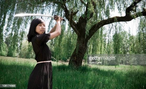 Young Ninja Girl In Summer Dress with Sword