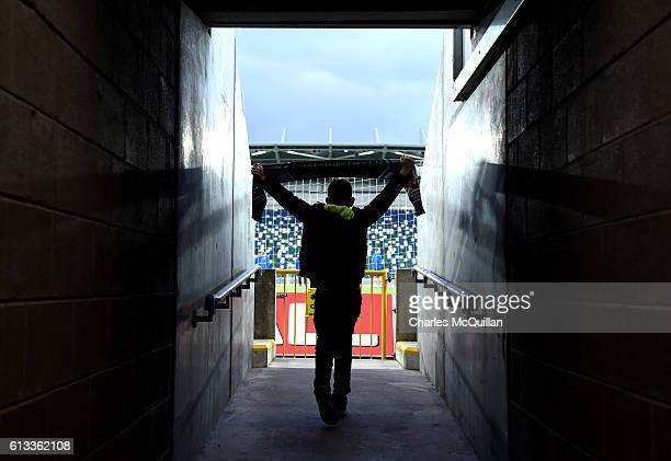 A young Northern Ireland fan makes his way into the newly refurbished stadium for the first time before the FIFA 2018 World Cup Qualifier between...