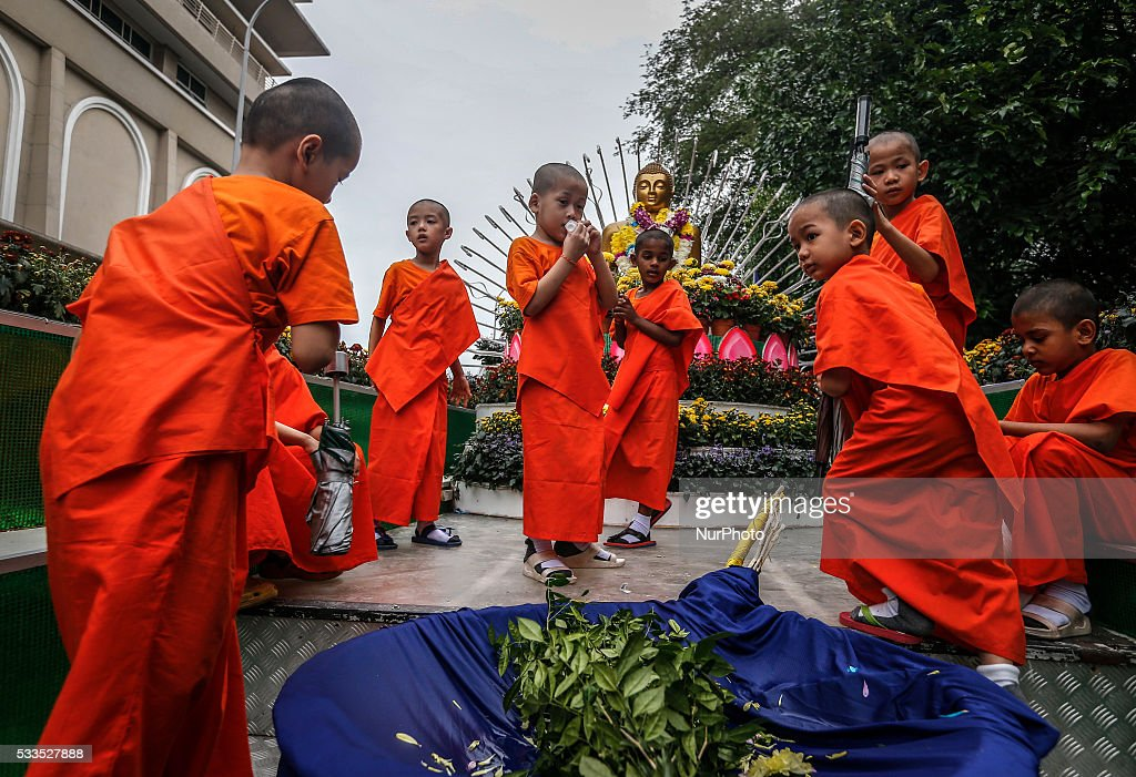 Young novice Buddhist monks wait for their turn to joint float procession during the Vesak Day celebration in Kuala Lumpur on May 21 2016