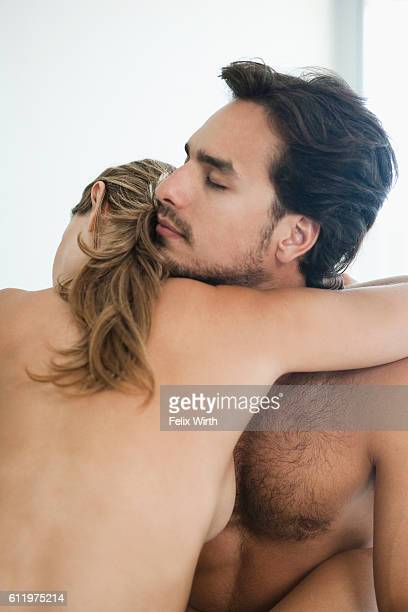 Young nude couple embracing