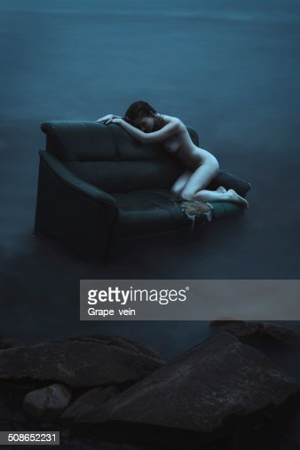 Young nude woman in the sea : Stock Photo
